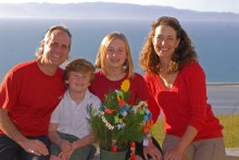 Our Christmas photo in Nelson, New Zealand, picturing our little seedling, which is topped by a cut-out sun because we celebrated the Summer Solstice and decorated the tree on the same day: December 21, 2009.