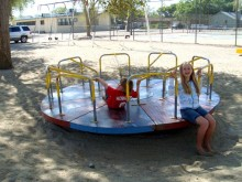 "We took time to stop at parks, like this one in Fallon, NV. The kids were delighted to find rusting and not-entirely-safe playground equipment from a previous generation. Colly forgot the word for ""merry-go-round,"" since she so rarely sees one, and said, ""They have one of those tables that spins!"""
