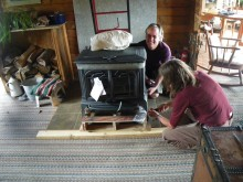 Day One: Morgan, Karen and David wrestle with the new stove.
