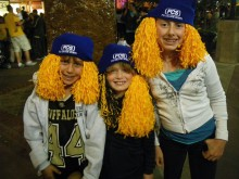Patrick, Kyle and Colly get caught up in a Buffs rally on Pearl Street.