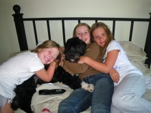Two things that make Colly most happy: her dog, and her friends. Here she's with Julie and Zoe.