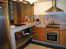 The kitchen is small, but so cool! There's a loft overhead.