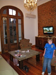Kyle in the living room, still vainly searching for English-language cartoons on the TV.