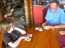 "A homeschooling ""Everyday Math"" lesson: Kyle practices addition and learns about probability while his grandfather teaches him Blackjack."