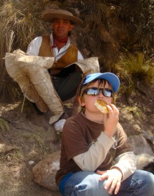 Kyle tries tortillas on the trail with the gaucho Orlando during our ride near Mendoza.