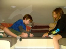 The kids enjoy playing cards on the loft in the RV ...