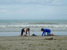 Colly and Kyle take a break from the surf to dig for treasure.