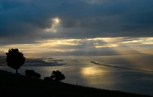The sun sets over Tasman Bay and the town of Nelson, a place that epitomizes beauty and tranquility.