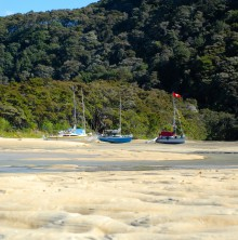 Boats in one of Abel Tasman's bays at low tide.