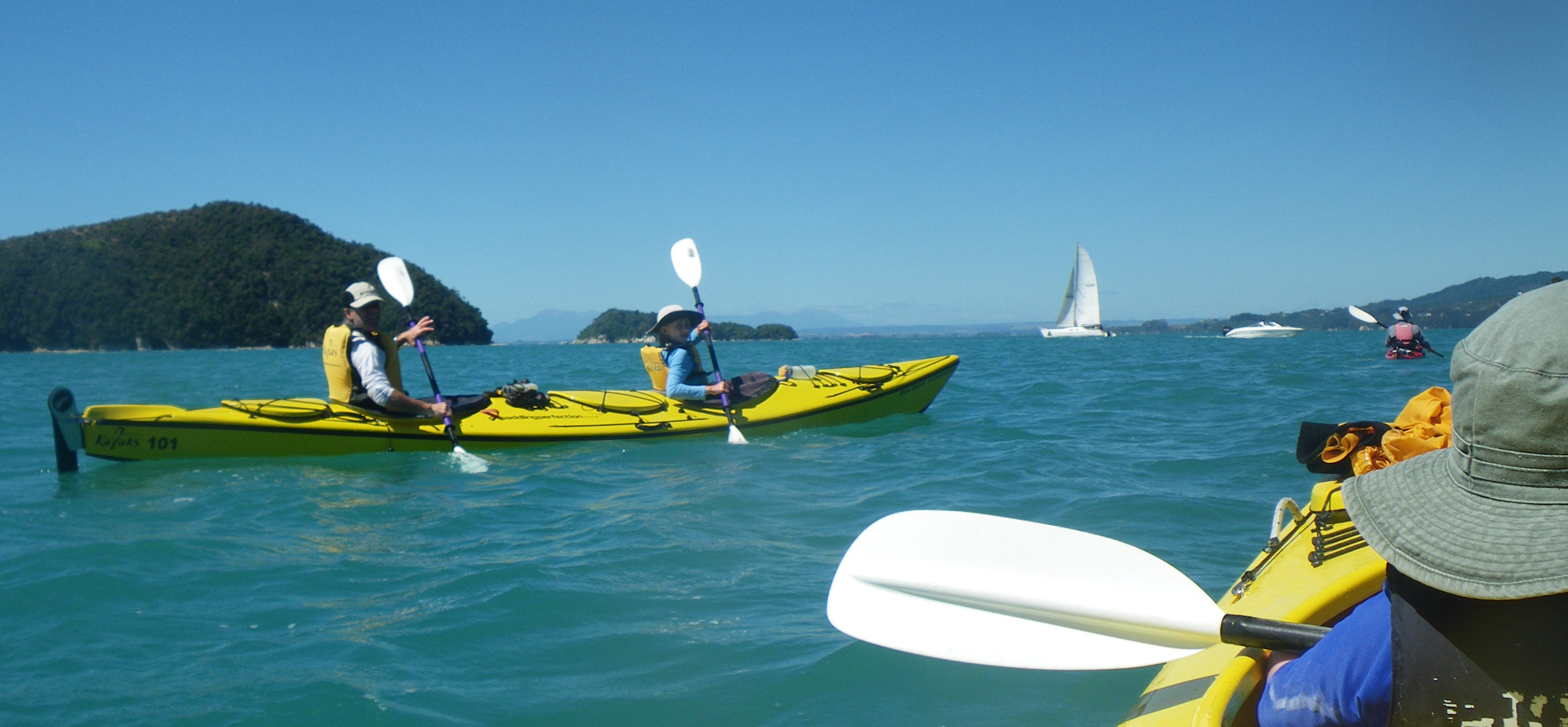 our day kayak adventure around nz s abel tasman park away together morgan and colly make a good team