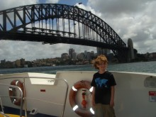 Kyle soaks in the Sydney Harbour scene. He's not the only one who's overdue for a haircut!