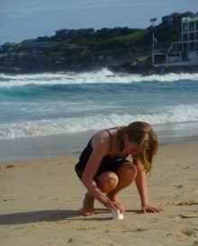 Colly with Bondi's waves behind her.